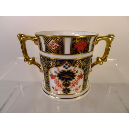 335 - A Royal Crown Derby old Imari 1128 loving Cup. 8cm tall. With box...