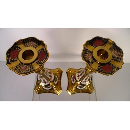 404 - A pair of of Royal Crown Derby old Imari 1128 dolphin based candlesticks, 27cm tall, with boxes...