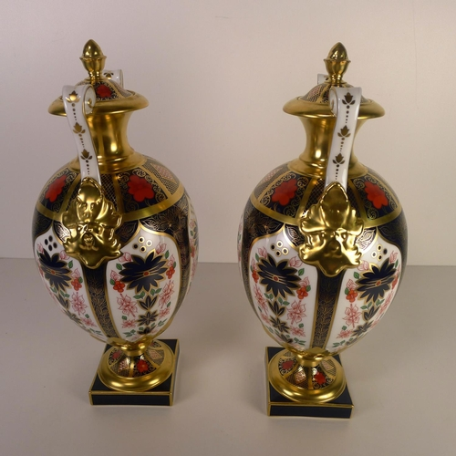 419 - A pair of Royal Crown Derby old Imari 1128 two handled Repton vases, 35cm tall, with boxes...