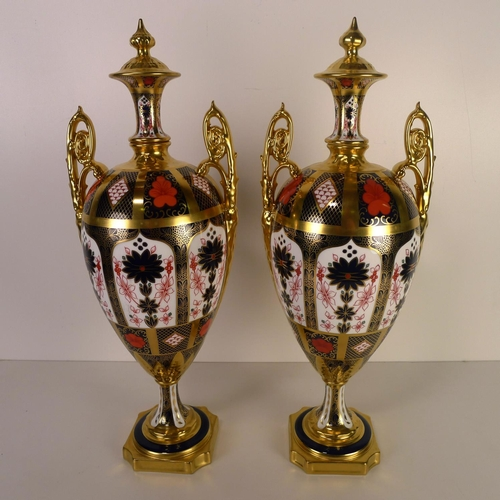 420 - A pair of Royal Crown Derby old Imari 1128 trophy vases, 43cm tall, with boxes...