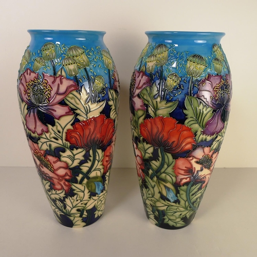 482 - A pair of modern Moorcroft pottery vases, 37cm tall, decorated with flowers & foliage, impressed & p...