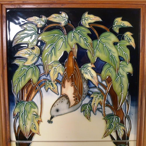 538 - A modern Moorcroft pottery framed two tile plaque, 50cm x 29cm overall, decorated with birds & folia...
