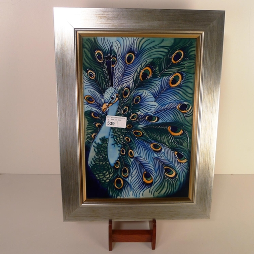 539 - A modern Moorcroft pottery framed tile plaque, 40cm x 30cm overall, decorated with a peacock, impres...