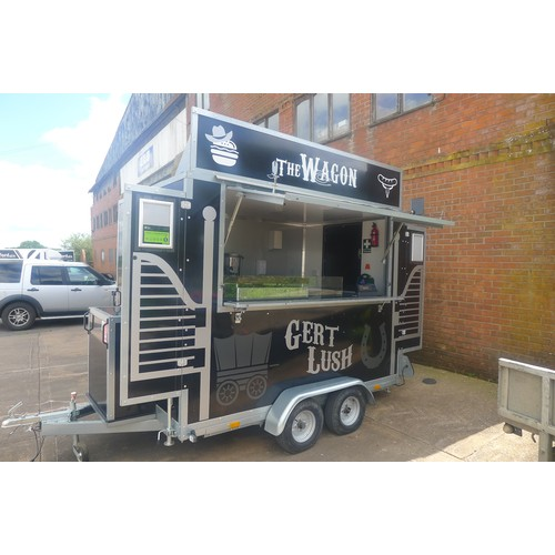 524 - A mobile Catering twin axle trailer, features lift up service hatch, stable type door to the side, s...