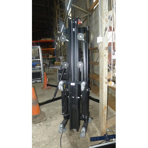 35 - 1 black metal folding manual lift by Mobiltechlift type ML4-6527 with an Al-Ko hand cranked 900 comp...
