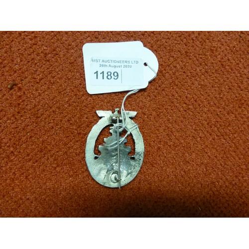 1189 - 1 German Nazi era High Seas Fleet badge believed to be a modern reproduction. The badge has a straig...