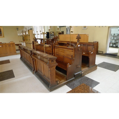 395 - A range of oak ecclesiastical choir stalls in 3 rows, with wooden seats and lectern backs, brass ele...