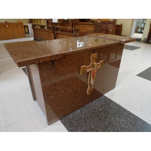 397 - A mottled granite altar unit with crucifix to front, approximately 175cms wide