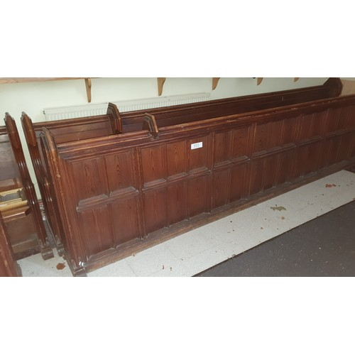 355 - A stained pine ecclesiastical pew, approximately 369cm wide, complete with a front panel section