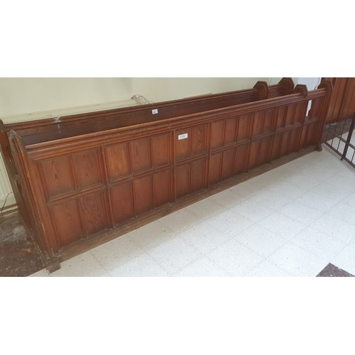 358 - A stained pine ecclesiastical pew, approximately 369cm wide complete with a front panel section