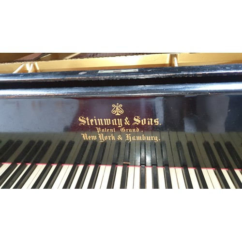 357 - A 1910 (?) black ebonized grand piano by Steinway and Sons. no 146722. However later information adv...