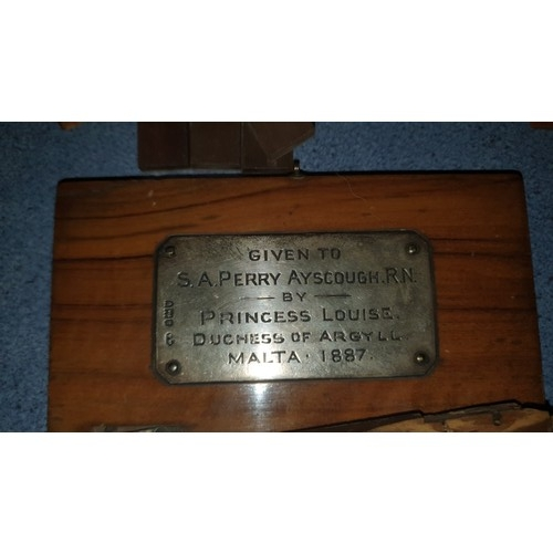 797 - A mahogany framed display cabinet containing a display of items relating to the Perry-Ayscough famil...