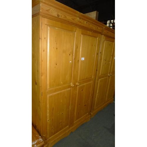 1257 - 1 pine two door wardrobe approx 122cm w x 56cm d x 194cm high...