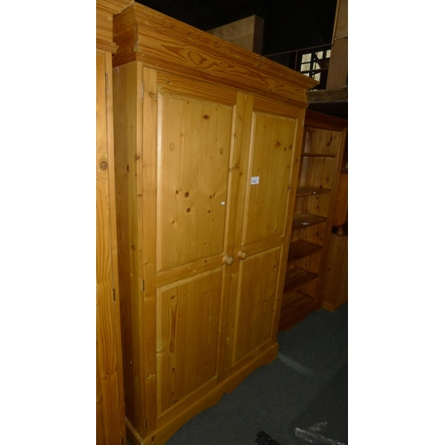 1258 - 1 pine two door wardrobe approx 122cm w x 56cm d x 194cm high...