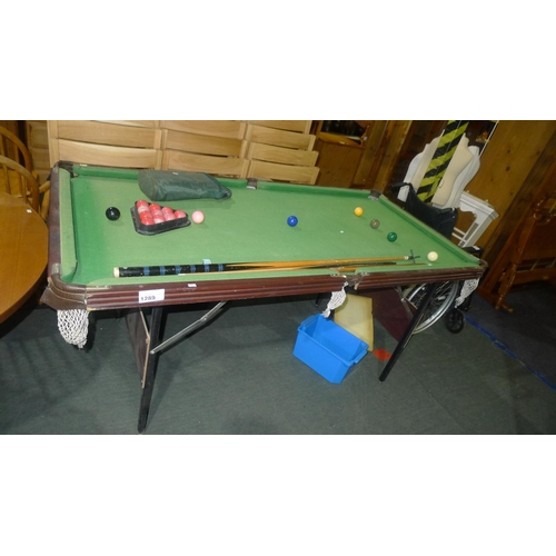 1289 - 1 snooker / pool table with folding legs approx 184cm x 94cm (6ft x 3ft) with 2 cues, a rest and a s...