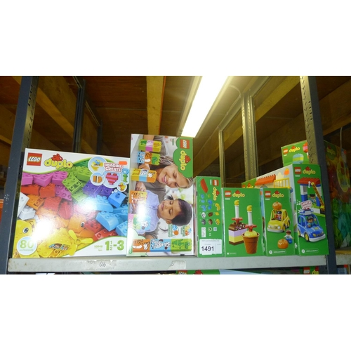 1491 - 6 x unused boxed sets of Lego Duplo, contents of 1 shelf...