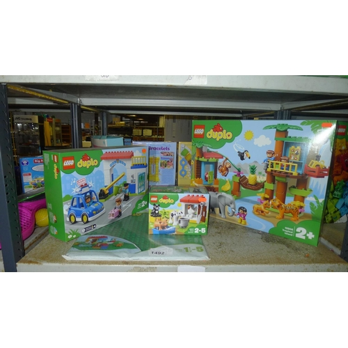1492 - 3 x unused boxed sets of Lego Duplo and a playboard, contents of 1 shelf...