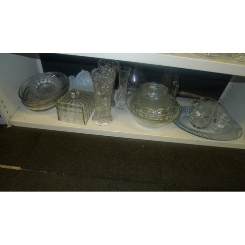 1037 - A large quantity of miscellaneous decorative cut and moulded glass ware (4 shelves)