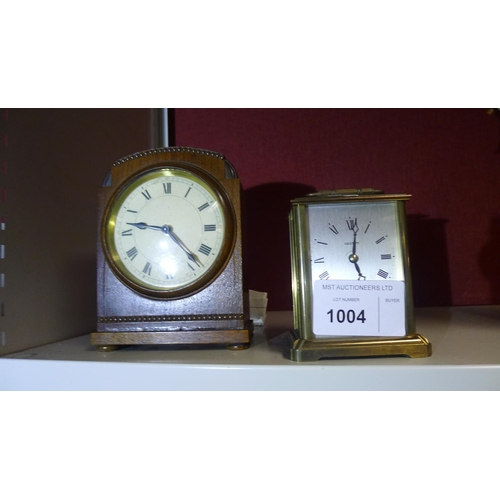 1004 - A small mahogany cased domed top mantle clock and a small brass carriage clock