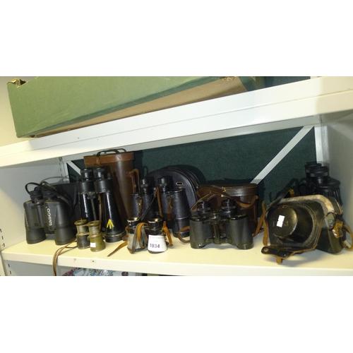 1034 - 7 pairs of vintage binoculars and 1 vintage petri camera