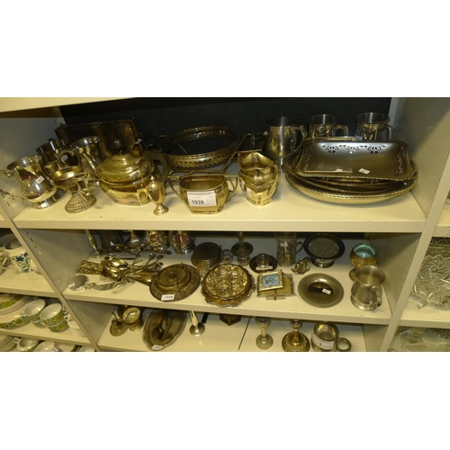1039 - A quantity of miscellaneous decorative silver-plated ware and cutlery etc (3 shelves)