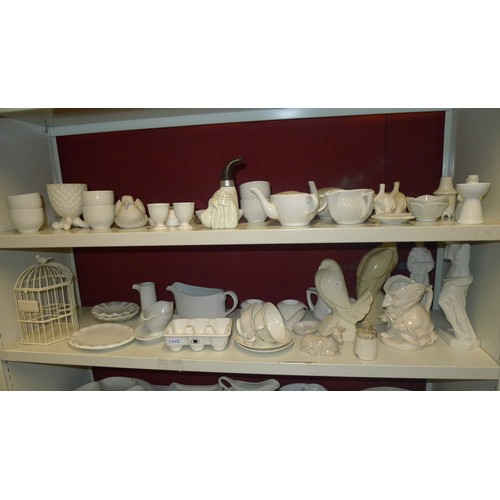 1002 - A large quantity of plain white decorative chinaware, household ware and ornaments etc (6 shelves)