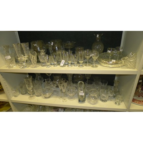 1045 - A large quantity of miscellaneous decorative cut and moulded drinking glasses and other glassware et...