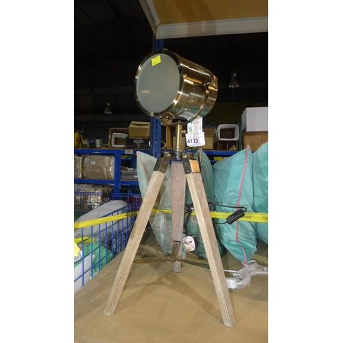 4133 - A searchlight style tripod table lamp...