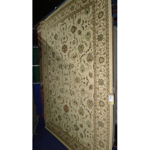 4513 - A traditional style cream patterned rug approx 160x235cm...