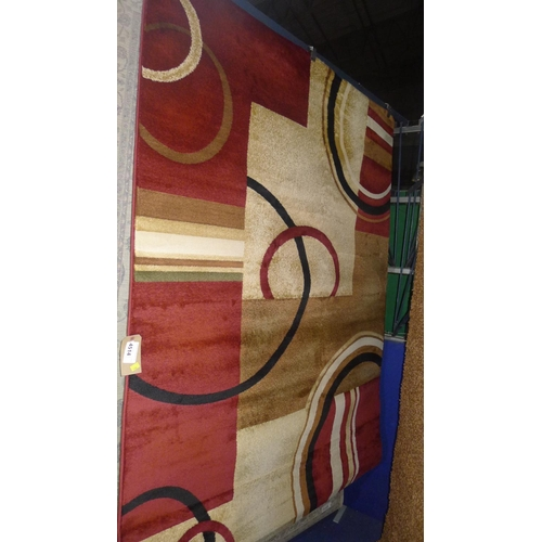 4514 - A red and cream patterned rug approx 160x220cm...