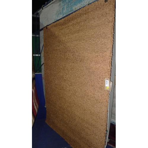4515 - A brown shaggy rug approx 140x200cm...