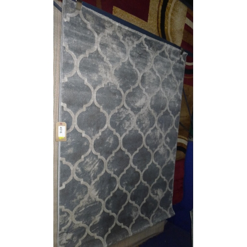 4516 - A grey trellis patterned rug approx 120x170cm