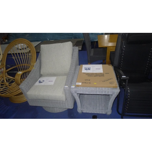 4647 - A grey wicker swivel garden armchair and matching coffee table with glass top and shelf beneath comb...