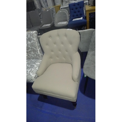 4700 - A cream upholstered dining chair...