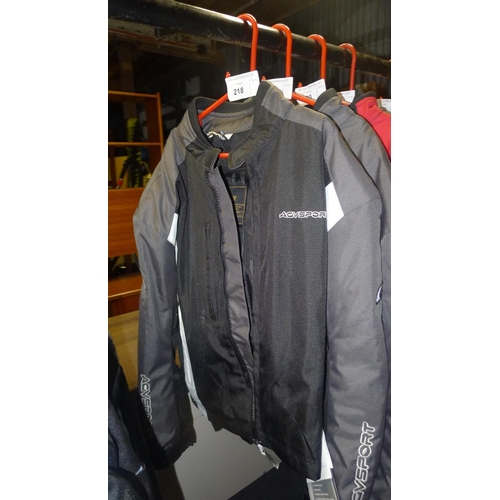 218 - A black motorcycle jacket size 40 by AGV Sport retails at approx £150...