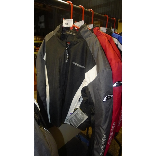 219 - A black motorcycle jacket size 40 by AGV Sport retails at approx £150...