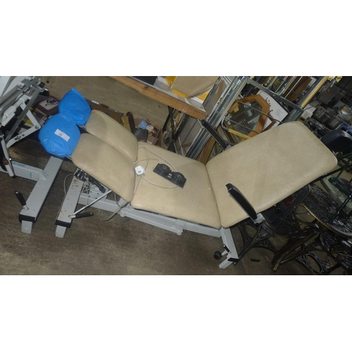 78 - An electric adjustable treatment bench/chair by Plinth...