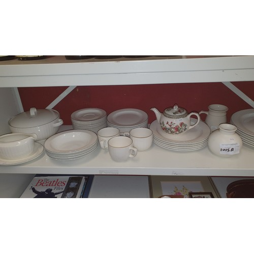 1015A - a quantity of various crockery including poole pottery, contents of one shelf