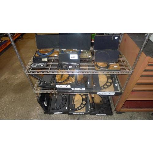 5068 - 12 various micrometers running from 1 inch to 12 inches. Contents of 3 shelves...