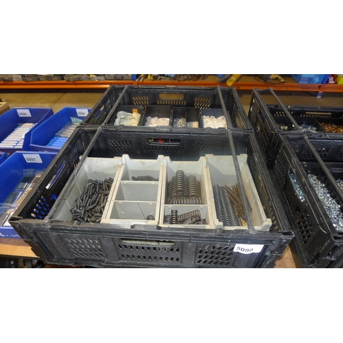 5099 - 2 black plastic crates containing a quantity of various springs and washers...