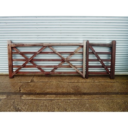 6023 - 2 tropical hard wood gates comprising of 1 at approx 244cm / 8ft Grade 5/5 and 1 at approx 91cm / 3f...