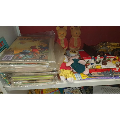 1007A - A quantity of various items including a number of Rupert annuals, lead figures, a triang snow plough...