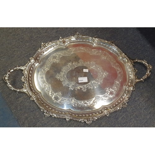 3151 - (H1) a large oval engraved silver tea tray with two handles approximately 59 cm long weighing approx...