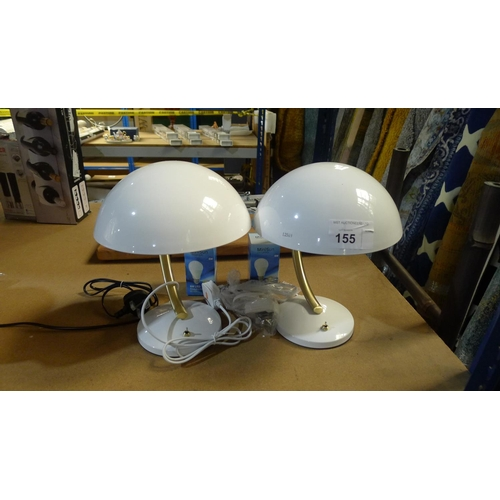 155 - A pair of white metal table lamps and 2 Minisun LED bulbs