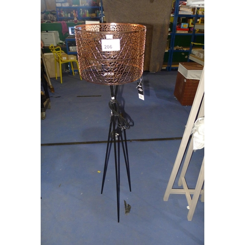 206 - 1 floor standing black metal tripod lamp with a copper coloured perforated shade approx 126cm high