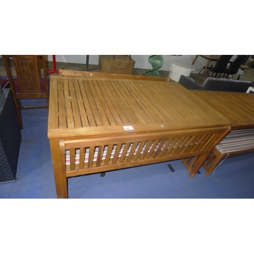 550 - A space saving tropical hardwood extending garden / conservatory table with four space saving benche...