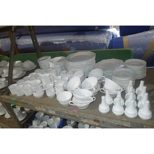 3014 - A large quantity of various white crockery by Wedgwood designed for hotels and restaurants including...