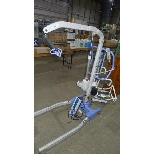 3241 - A care home hoist by Linak/sunrise medical type OXF- Advance, comes with 2 x batteries and wall moun...