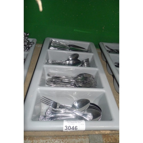 3046 - A plastic cutlery container, containing a quantity of  cutlery