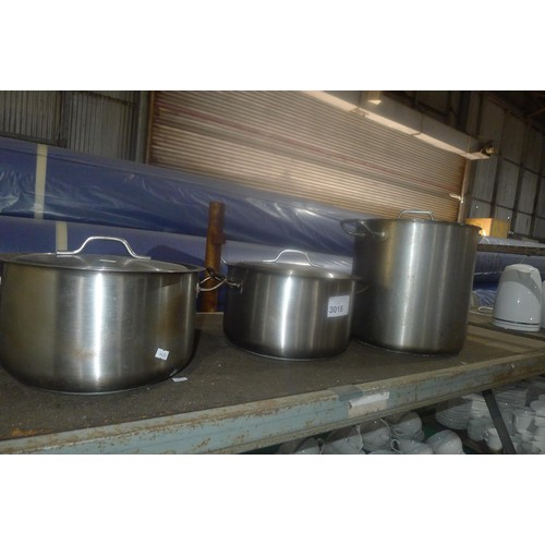 3018 - 7 chopping boards with a stainless steel stand, and 3 stainless steel cooking pots with lids